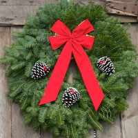 This classic style Christmas Wreath is as traditional as Christmas itself! Our wreaths are all handmade with the freshest Minnesota Balsam Fir. This Christmas Wreath is also beautifully decorated with selected white-tipped & glittered pinecones, festively accented with jingle bells and trimmed with a gold-backed, red velvet bow. The Classic Christmas Wreath is the most popular with our fundraising program customers.*The most popular size of the Classic Christmas Wreath is 25 inch diameter It is also available in 28, 36, 48 and 60 inch diameter.
