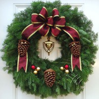 The Victorian Wreath offers a taste of Old World craftsmanship to your Christmas Wreath Fundraiser. Handcrafted from Minnesota Balsam Fir, the Victorian Wreath is trimmed with an exquisite burgundy bow with imprinted wired edges. Natural bronze pine cones accented with gold jingle bells and unbreakable satin finished Christmas Bulb Ornaments complete this enchanting Fundraising Wreath. *The most popular size of the Victorian Christmas Wreath is 25 inch in diameter and is also available in 28 inch and 36 inch diameter.